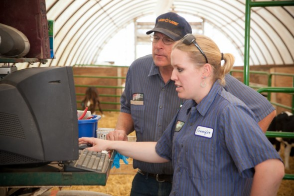 Kenton Holle and daughter Jennifer at family-operated Northern Lights Dairy in Mandan, N.D.