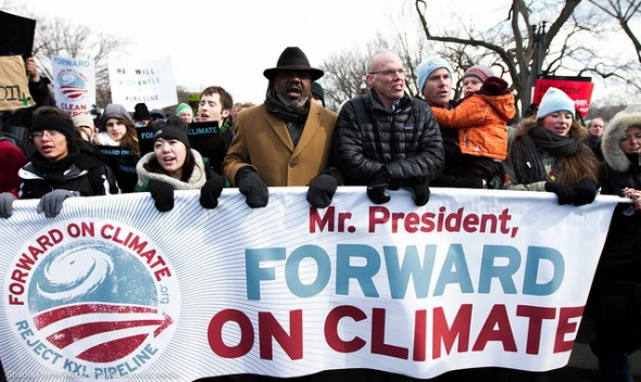 Bill McKibben marching with crowd at climate rally in Washington, D.C., Feb. 12, 2013