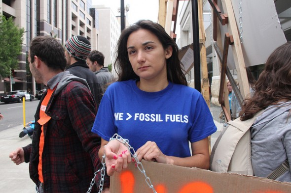 Student activist Victoria Fernandez chained herself to a mock oil rig as a protest against UC fossil fuel investments at a May 2013 Board of Regents meeting in Sacramento, Calif.